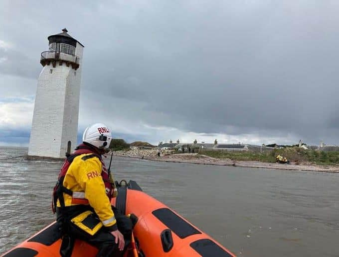 RNLI pluck fisherman from the sea Near Southerness